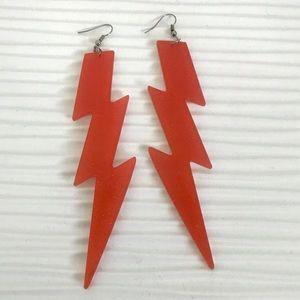 Orange acrylic sparkle thunderbolt earrings